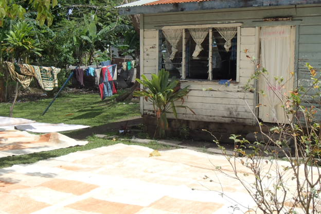 Tapa drying outside a home near school