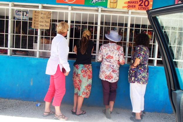 Grabbing some ice blocks at a village fale koloa (shop)