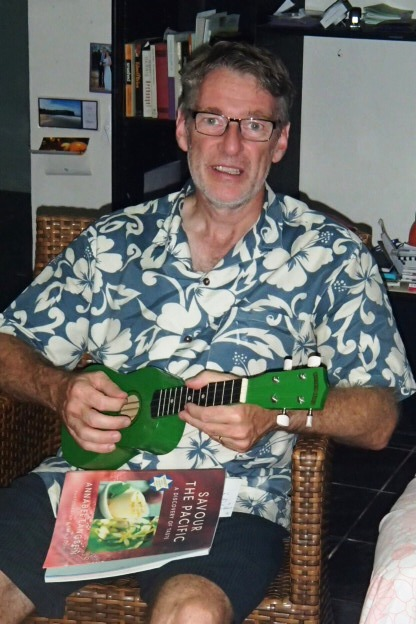 Kotoni with his new ukelele... tip toe through the taro?