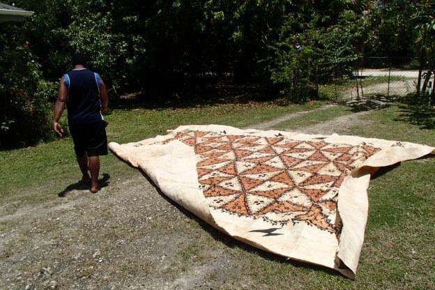 Levi our Fijian neighbour drying a tapa he bought to send home