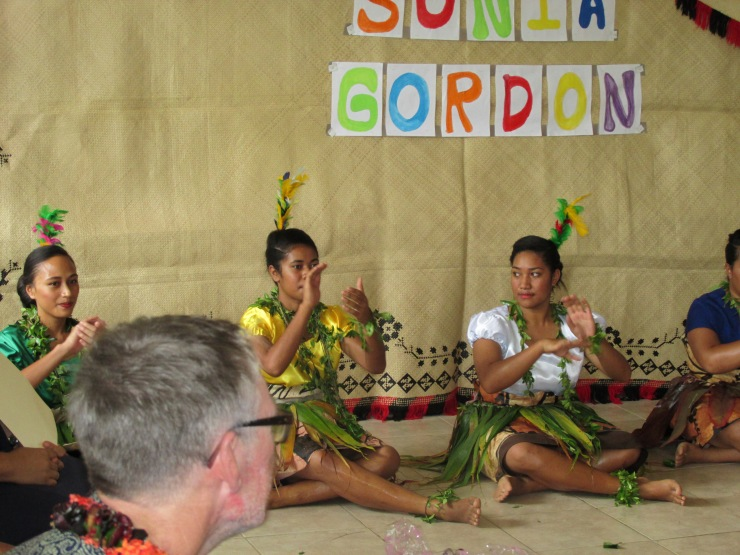 Fashion students doing a group dance in beautiful tapa costumes made that morning